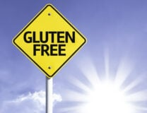 A yellow road sign says Gluten Free in bold letters