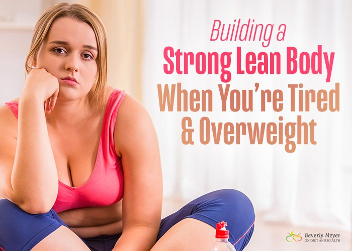 Unhappy overweight woman in exercise clothes