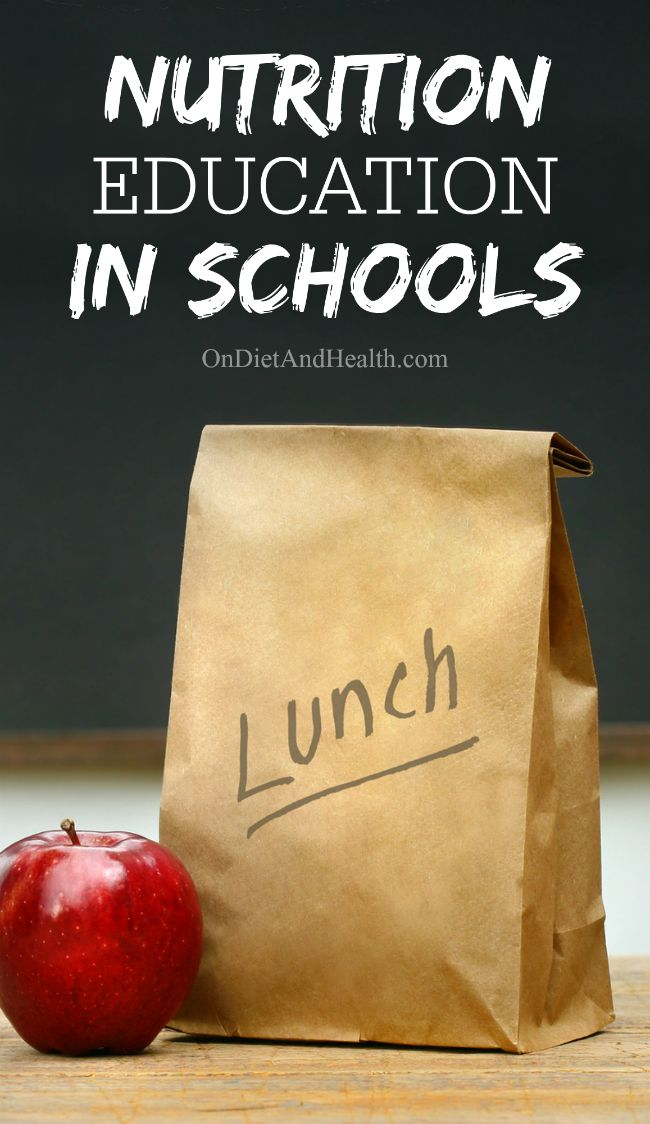 Bagged lunch in brown paper bag with lunch written on the side and apple beside