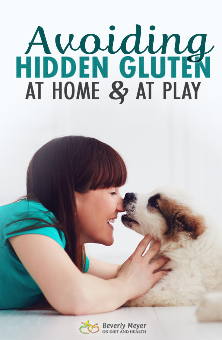 Young woman kissing her puppy on the nose. Is there gluten on that puppy's nose?