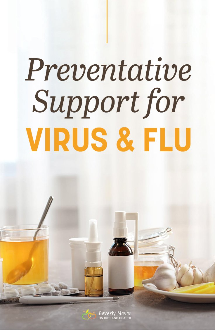 A table with tea, lemon, herbs and garlic suggests preventative support for virus and flu