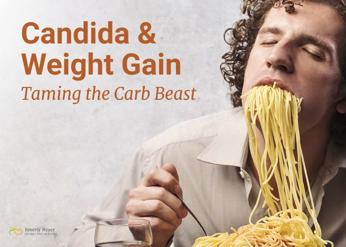 A man is shown with huge mouthfuls of pasta . Do Carbs cause weight gain?